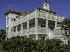 This beautiful oceanfront home sits directly on a golf course in Palm Coast, Florida.