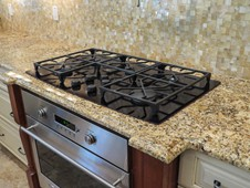 Gas cooktop and granite countertops  - manor home - Ormond Beach FL
