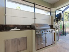 Outdoor kitchen - narrow lot home -Flagler Beach Florida