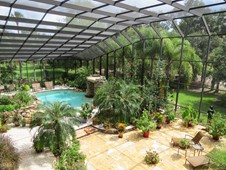 Pool enclosure and landscaping - manor home - Ormond Beach FL