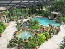 Pool with landscaping and waterfall - manor home - Ormond Beach FL